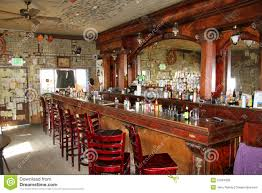 Inside of an old wooden bar with mirror