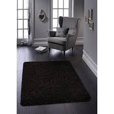 this is a product shot of buddy buddy easy care rug black 67cm x 150cm