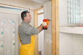 using electric drill. worker installing gypsum board, using electric drill or screwdriver stock photo - 48656615 o