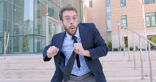office centre video. unique centre handsome millennial businessman celebrating and silly goofy dancing  directly into the camera his achievement and office centre video l