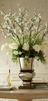 Another idea for tall white altar bouquets with architectural interest top  and at base.