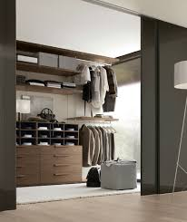 View in gallery Exclusive walk-in closet design from Jesse with sliding  black doors