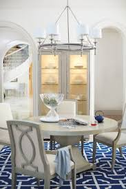 the criteria round dining table by bernhardt makes a statement in any dining room constructed with ash solids and quartered ash veneers this piece has a