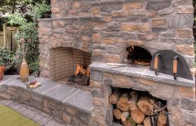 outdoor patio and backyard medium size corner fireplace patio covered pizza oven outdoor with spaces traditional
