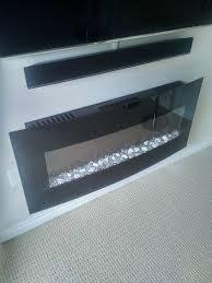 tv soundbar and wall mounted fireplace