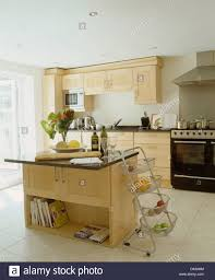 Limestone Kitchen Floor Tiles Vegetables In Tiered Metal Storage Baskets Beside Island Unit In