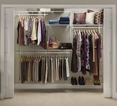 invest in a closet organization system to add shelf and hanger space