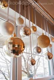 a great alternative use for ornaments hang them from a curtain