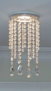 magnetic potlight recessed light chandelier in clear crystal. Outer trim  measures 4.5