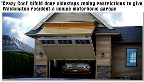 regular look garage door opens to a motor home garage door schweiss bifold liftstrap door 12 ft wide with a 14 ft tall clear opening making the total