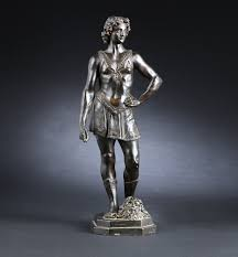 Andrea del Verrocchio (after). Figure in patinated bronze, David with  Goliath's severed head at his feet