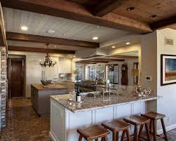 Country Cottage Kitchen Cabinets Cream Kitchen Cabinets Surround The Contrasting Darker Island In