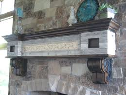 a hand made salvaged barnwood fireplace mantel with wrought iron scrolling made to order from iguana art design custommade com
