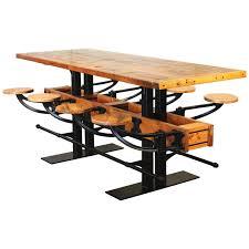 Industrial furniture table Black Industrial Pub Table The Jepara Goods Industrial Pub Table With Swingout Seats Vintage Industrial Furniture