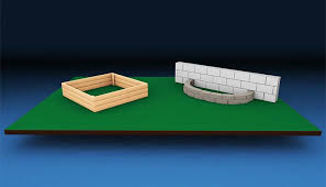 building garden beds. wood and concrete wall block raised garden beds. building beds