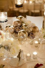 picture of diffe silver ornaments on a glass plate can become a great winter wedding centerpiece
