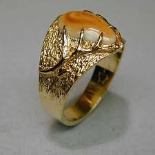 goldsmiths such as bill coffey utilize elk ivories diamonds turquoise and various other fine gemstones to custom design contemporary jewelry for his