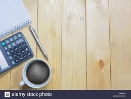 Top view office table with paper and coffee and calculator and pen