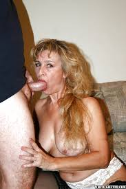 Mature woman enjoys blow job