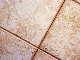distressed ceramic floor tiles create rustic aura