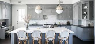 white and gray kitchen with blue french bistro counter stools