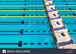 olympic swimming pool lanes. Beautiful Olympic Sport Competition Swimming Pool Lanes In A Clear Transparent Blue Water Facility - Stock L