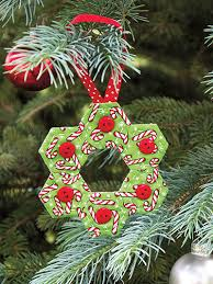 Get 30+ Christmas quilt patterns when you download today! Let your ... & Quilted Christmas Ornament / Supplies: candy cane fabric, sizing and  buttons. Adamdwight.com