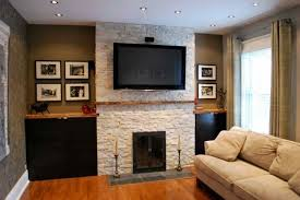 contemporary fireplace. This Contemporary Fireplace Has A Wooden Mantle And Overhead TV.