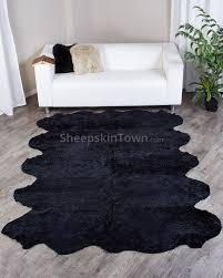 black curly shorn new zealand sheepskin rug