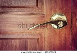 old doors gold handles locks lattices and wood door with black border in