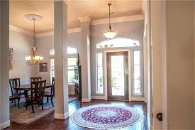 entry chandelier lighting foyer lighting for high ceilings spectacular interior ceiling with glass door round fl home
