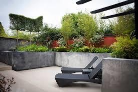 hillside contemporary furniture. Concrete Contemporary Patio With Wicker Furniture Garden Raised Flower Beds Hillside M