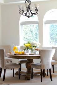 round kitchen table sets round kitchen table sets dining room traditional with arched window chandelier iron