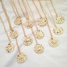 modern zodiac gold medallion pendant