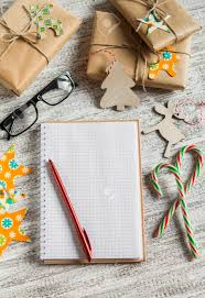 blank open notepad gifts cans on a light wooden surface stock photo