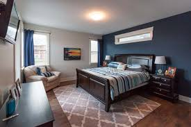 master bedroom feature wall: master bedroom painted in grey owl with hudson bay blue feature wall