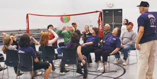 chair volleyball net. students from chieftain elementary recently challenged senior citizens the scenic hills center to a game of chair volleyball at school. net
