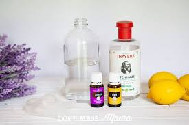 diy air freshener closeup of glass spray bottle witch hazel lavender lemons and essential oils