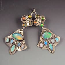 this pair followed my typical multi gem structure a smaller piece at the top which is soldered onto the earwire from which hangs a larger piece or pieces