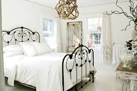 ... Light and airy bedroom in white with shabby chic and coastal touches  [Photography: Mina