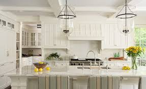 stunning traditional kitchen with coffered ceiling creamy off white kitchen cabinets endless white kitchen island marble countertops sink in kitchen