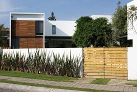 Impressive Nice House Fence Wall Designs That Has White Fence Can
