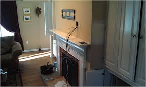hide tv wires over fireplace how to install a tv a fireplace