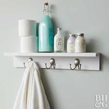 white bathroom shelf with hooks off 51