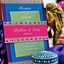 wedding invitation ideas royal indian wedding invitations mixed with blue green crystals accessories on artistic
