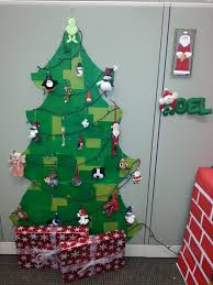 the office ornaments. Cubicle Christmas Tree Made From A Large Piece Of Cardboard Covered In Squares Colored Tissue Paper And Pinned To The Wall. Ornaments Office T