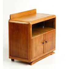 small cabinet with rounded corners sliding glass windows and rosewood wooden door knobs