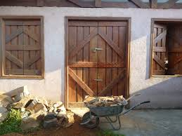 wood house window building home shed rustic work porch cottage backyard door stable shutters windows doors