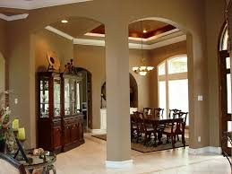 formal dining rooms with columns. graceful archways and columns set off the formal dining room. vaulted ceiling has crown rooms with