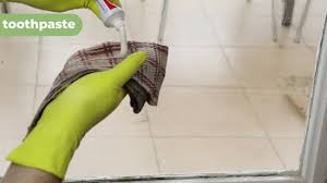 remove hard water stains from glass